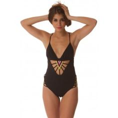 This v-neck one-piece by Mara Hoffman features ruched triangle cups. Beaded cutout straps at front and sides. Hook-and-eye closure at back. Adjustable spaghetti straps. Lined.