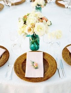 Rattan charger with fresh floral napkin decor which coordinates with table centerpiece.    Repin by Inweddingdress.com