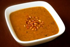 Black Bean Soup is kicked up a notch with the addition of some delicious pumpkin! Detailed recipe and photographs included.