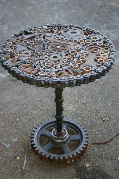 Rust Art - Recycled Metal Sculpture / Table. This is amazing! I totally want one for the back yard.