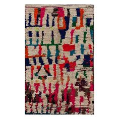 hand-knotted by Berber rug-makers in Morocco