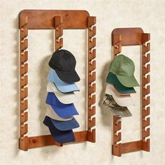 The solid wood Cap Display Rack is handcrafted. Vertical rack keeps hats and caps from cluttering floors and dressers. Cap rack is a great way to display a collection of hats from your favorite sports teams. Wall Hat Racks, Diy Hat Rack, Wall Mounted Hat Rack, Baseball Hat Racks, Baseball Caps, Baseball Hat Organizer, Baseball Hat Display, Cowboy Hat Rack, Cowboy Hats