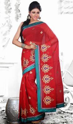 Pristine Red Jute Silk Embroidered Saree Soak in a sea of compliments red jute silk saree featuring embroidered decorative buttis all over. Bold motifs adorning the lower part aggrandizes the look. Comes with a matching stitched round neck blouse with 6 inches sleeves.  #SilkEmbroideredSaree #UniqueFancySarees