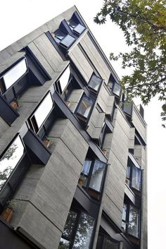Image 22 of 24 from gallery of Brutal Variety / Ero Architects. Courtesy of Ero Architects Brick Architecture, Architecture Magazines, Futuristic Architecture, Amazing Architecture, Contemporary Architecture, Condominium Architecture, Chinese Architecture, Architecture Office, Design Exterior