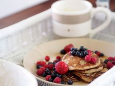 Banana pancakes with some fresh berries