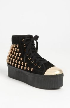 Platform sneakers by Jeffrey Campbell. Do you dare?