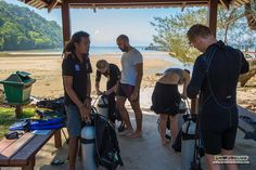Staff Instructor Mel and his Divemaster assistant and protege Ahmad supervises their group of PADI Open Water Diver students to assemble their dive gear :)