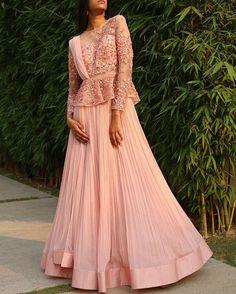 The #RidhiMehra rose pink peplum lehenga is our favorite for summer weddings!  To shop this outfit, mail at shop@ridhimehra.com  #Lehenga #Pink #SS16 #IndianFashion #WomensFashion #WomensWear #Designer #Wedding #IndianWedding #Summer #Love #Shopping #Delhi #Mumbai #Bangalore #Chennai #Kolkata #Hyderabad #India #Dubai #Kuwait #Jakarta #Melbourne #London
