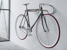 The Minimal Wooden Bike Hooks by Fluo can transform your bicycle into a piece of hanging artwork. These handsome American black walnut bike hooks. Rack Velo, Bicycle Hanger, Wall Mount Bike Rack, Diy Bike Rack, Bike Hooks, Indoor Bike Storage, Bicycle Storage, Home Bike Rack, Crochet Velo