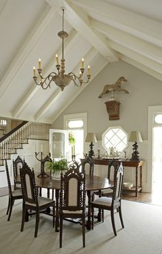 vaulted ceiling and round table-beautiful chairs, lighting, black forest lamps....love it all....