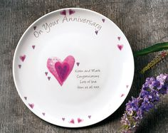 Hearts Anniversary Plate The perfect gift for any anniversary. bone China plate, beautifully decorated with hearts. 'On Your Anniversary' is pre printed, personalise with any message up to 4 lines. 30 characters per line.