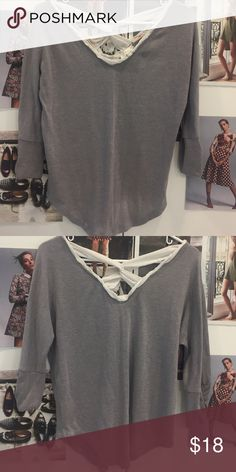 Anthropologie criss cross back top XS Worn couple of times still lots of life left 👚polyester/rayon/spandex. Anthropologie brand Deletta made. Criss cross back detail and lining on the neck is beautiful. Anthropologie Tops Blouses