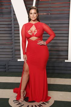 Ashley Graham wears a red gown with strappy sandals on the red carpet at the  Vanity Fair Oscar Party in Los Angeles, Feb. 28, 2016. #ashleygraham #redcarpet #reddresses #oscars Shirred Dress, Belted Dress, Ruffle Dress, Curvy Girl Fashion, Plus Size Fashion, Plus Size Dresses, Plus Size Outfits, Ashley Graham Outfits, Red Gowns