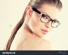 Beauty portrait of pretty girl wearing stylish eyeglasses. Young attractive glamour Caucasian woman with naked shoulders posing in studio.