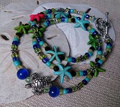 Starfish and sea turtle necklace bracelet on Etsy, $25.00
