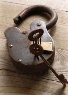 This is a working padlock with two keys. Crafted from heavy iron and brass and comes with 2 keys. An attractive iron lock that is fully functional with an old style locking system, simply swing the brass cover open to access the keyhole.