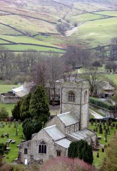 The 11th century St Wilfrid's Church in the village of Burnsall, Yorkshire, UK