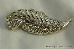 Women's costume jewelry gold tone brooch leaf design w/ rhinestones down center