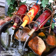 i want to make a water fountain or water feature with wine bottles. I think they are a bit quirky and fun for a patio and a great conversation topic!