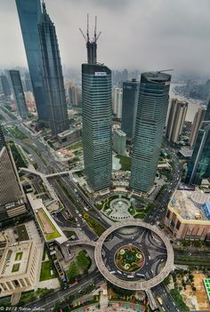 The newly finished Lujiazui Pedestrian Bridge in the Pudong district of Shanghai forms an elevated public space where those on foot can stroll along a circular high line, far above the noise and. Great Places, Places To See, Beautiful Places, Wonderful Places, Amazing Architecture, Landscape Architecture, Places Around The World, Around The Worlds, Foto Picture
