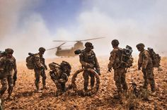Soldiers of 82nd Airborne Division gather their equipment before boarding a CH-47F Chinook that serves with Task Force Flying Dragons in Kandahar Province, Afghanistan, May 25, 2014. The Flying Dragons flew in support of a joint air assault in which Soldiers conducted a search for illegal weapons on various compounds.