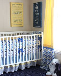The Caden Lane chevron crib bedding in blue, yellow, and grey is perfect for a nursery or big boy room!