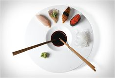 """One for the Sushi lovers! the """"Sushi-Time"""" Sushi Plate by Mint design, is perfect for serving sushi. It features a generous surface for prepared sushi and sashimi, and a dipping dimple in the center for holding soy sauce. The surface of the plate slightly slopes inward, ensuring that any excess soy-sauce and wasabi goes back into the dipping dimple. Two sets of wooden chopsticks are included so you can share with your loved one."""