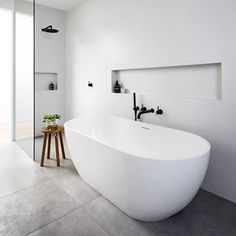 Everybody loves a free standing bath. This great project was beautifully built by @madeform_ Styled by @larrittevans & Photo @emily_bartlett_photography #dxarchitects #seddonarchitecture #architecture #melbournearchitecture #melbourne #seddon We will post some more photos of our recent Seddon renovation soon
