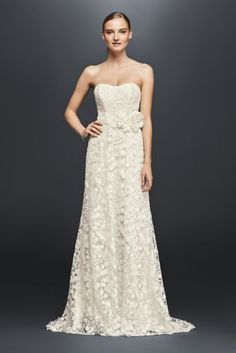 The simple silhouette of this strapless A-line lets the unique detailing shine through. Intricate floral lace is made even more whimsical by embroidery and tiny sequins, while a hand-crafted floral sash adorns the waist. Perfect for the bride with a fun, vibrant personality.  Cheers Cynthia Rowley, a David's Bridal exclusive  Polyester  Sweep train  Back zipper; fully lined  Dry clean  Imported