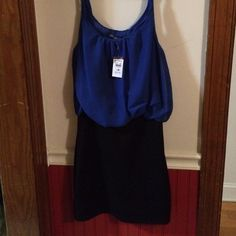 NWT Royal and Black Dress Fitted. Bottom of dress (black area) measures 16 1/2 in. From top of shoulder to bottom is 35in. Gathered at waist so top of dress looks like it's tucked in. Very cute. Very sexy. Dresses Mini