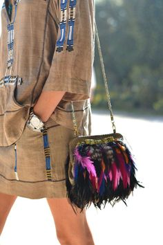An Angel Jackson feather bag adds emphasis to the tribal elements of an Isabel Marant ensemble.