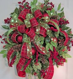 Make Custom Wreaths - go to bottom of the page & watch 30 minute video on how to make double bow wreath. This lady is selling her wreaths on Etsy for a lot of money, they are full & gorgeous.