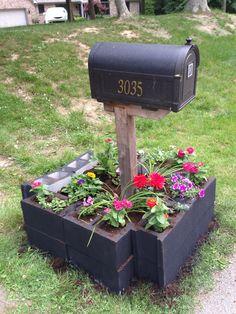 Cement block raised flower bed