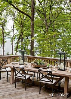 gorgeous deck with a beautiful view. love the table.