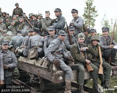 Finnish soldiers and German Waffen-SS volunteers on a rail cart in Kiestinki, Karelia, 22 August 1941 - pin by Poop stain Luftwaffe, Eastern Front Ww2, Colorized History, George Patton, Germany Europe, German Army, War Machine, Military History, World War Ii