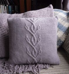 Cornflower cable cushion - free pattern.