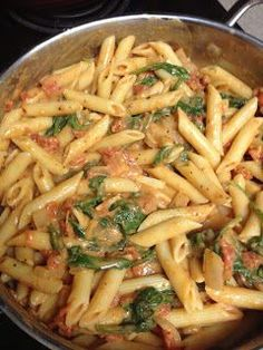 Tomato & Spinach Pasta :: I substituted goat cheese and Greek yogurt and topped with some chicken