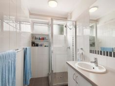 The renovated bathroom and laundry at the Mount Eliza home unit / apartment for sale.