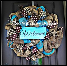 Summer Wreath Wreath Deco Mesh Wreath Deco by RedWithEnvyDesigns. I really like the colors and the burlap, polka dot and other ribbon in this. If you are crafty I am sure you could easily make this a DIY project.