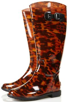I NEED these. Like have an actual need for, rather than merely a want. Dino tortoiseshell wellies.