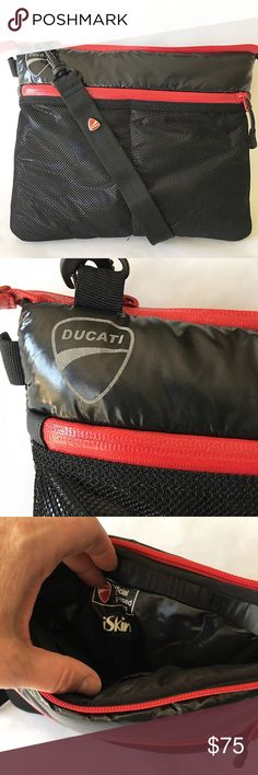 Ducati Puffer Jacket Style Cross-body Bag This puffer jacket style Ducati bag by iskin is cute, soft and versatile. Black with red accents and in mint condition. Main compartment can hold an iPad or whatever. I used it for a cross-body travel bag. Elastic band in the back fits over a suitcase handle too. Has 2 net zipper pouches on the front and an adjustable heavy duty strap. These were from the Ducati collection and seem to be rare and unavailable now. The strap has carabiner clips which…