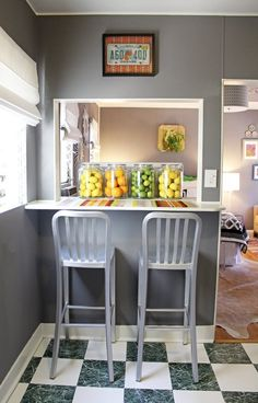 Apartment Therapy...Replace the fruit bowl with a fruit jar. Like the chairs, too.