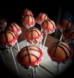 Basketball cake pops we took an orange edible marker to lightly sketch out where the brown ball marks would go. Then the net went on free-hand. Finally, it was all finished off with the red for the rim. By Cakepop central Basketball Cake Pops, Basketball Party, Basketball Birthday, Sports Party, Basketball Hoop, Basketball Wedding, Basketball Stuff, Volleyball, Soccer