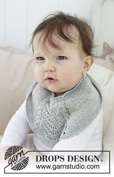 Giggles in Gray - Baby bib with cables and lace pattern. The piece is knitted in DROPS Baby Merino. Free knitted pattern DROPS Baby 29-16