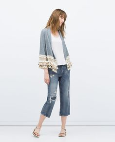 open draped cardigan with fringe/pompoms