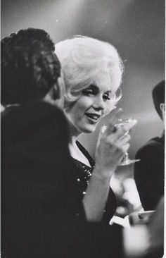 Marilyn at the Golden Globes Awards with Jose Bolanos on March 5, 1962. Photographed by Gene Daniels