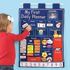 Wall Hanging Daily Planner for Kids!  Now our charming, embroidered first planner offers even MORE! It not only teaches the calendar, seasons, and weather, it helps kids plan their day and express their moods.