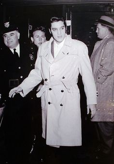 Elvis rockin' the trenchcoat