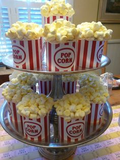 EASY MOVIE THEATER BIRTHDAY PARTY & POPCORN CUPCAKE DIY (with a free popcorn bucket download)    Keep these in mind if you plan on having your reception at The American Theater in Charleston! I can't believe they're cupcakes!