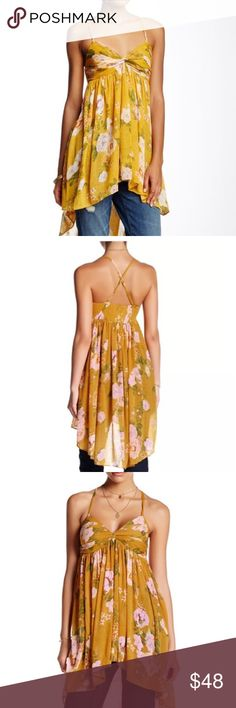 NWT Free People Flowy Tunic Top Adjustable straps, cross cross back, high low hem. All over floral print. Very light weight and airy. Fits true to size. Brand new, unworn with tags. Free People Tops Tank Tops